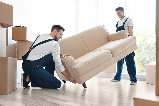 Packer & Mover carrying a large sofa